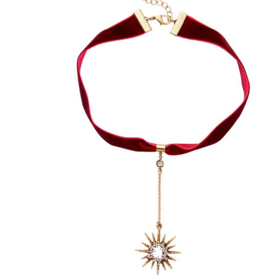 Luxe Statements Velvet Red Ribbon Crystal Star Choker on a white background.