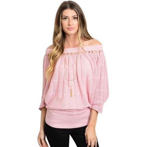 Luxe Statements Pink Off Shoulder Top on model with black jeans and a white background.