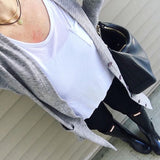 A casual outfit with a white tee and black pants, topped with the leather coin choker