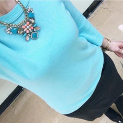 Leslie Statement Necklace over a casual turquoise sweater