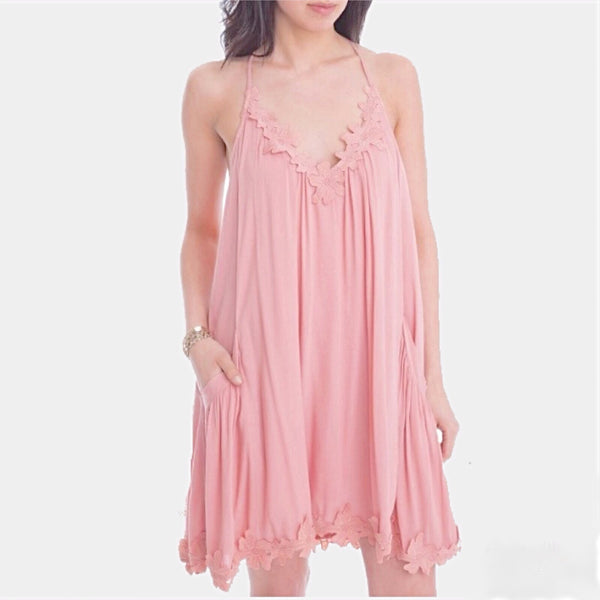 Luxe Statements of spaghetti strap pink summer dress on woman.