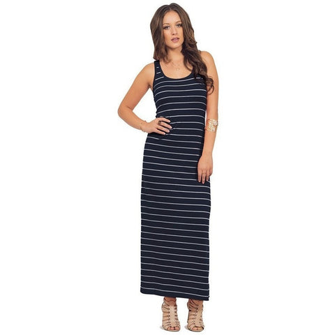 Model wearing a Luxe Statements  blue striped maxi dress in front of white background.