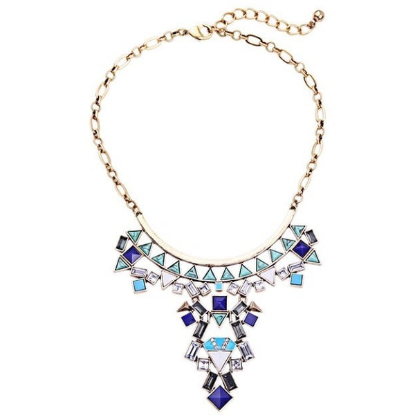 blue chandelier statement necklace on white background