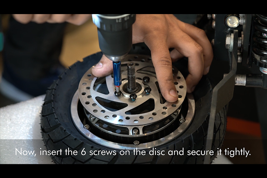 Place the disc back on the wheel, and insert the screws and washer.