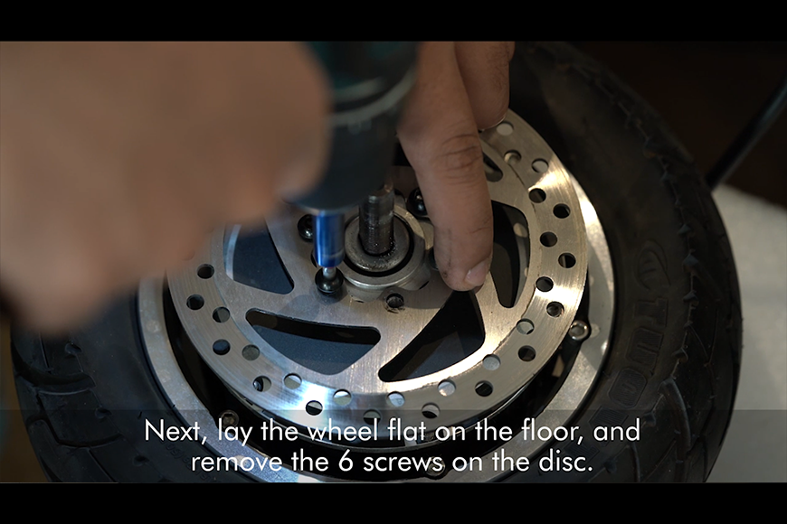 Remove the 6 screws on the wheel.
