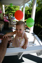 baby with balloon party decorations