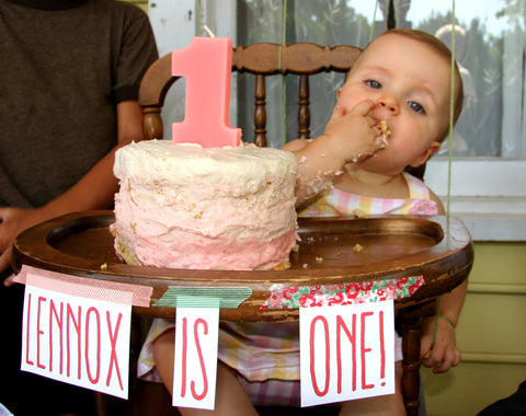 baby eats her ombre pink strawberry birthday cake from washi tape decorated tray