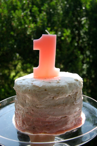 ombre pink tall round birthday cake for first birthday party for a little girl