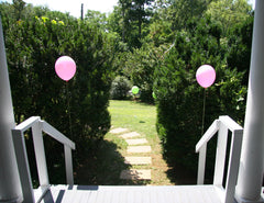 Pink argyle balloons at front porch party entrance