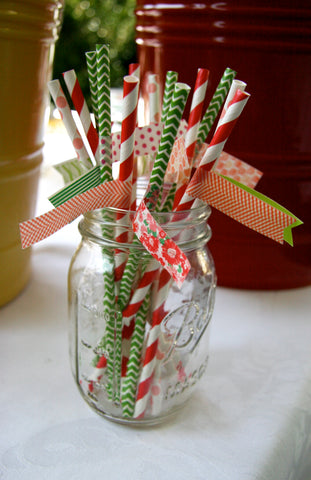 green chevron paper straws, red striped paper straws and coral dot paper straws with washi tape flags in a mason jar