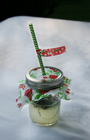 vintage floral cloth covered mason jar with paper straw and floral washi tape flag