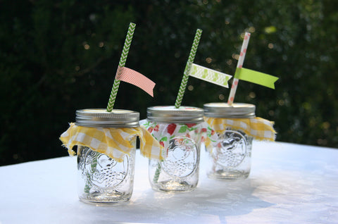 cloth covered mason jars with paper straws and washi tape flags for summer event