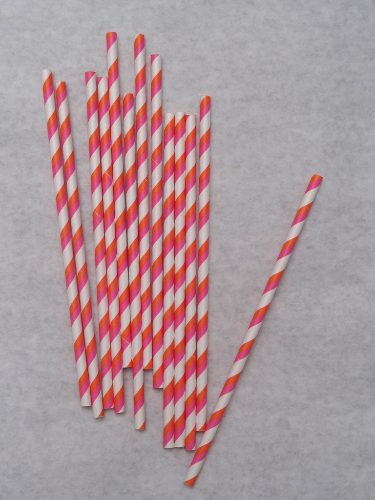 Pink and orange striped paper straws are great for summer parties.