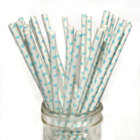 Light blue polka dot paper straws for a gender reveal party.