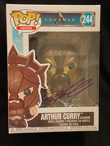Jason Momoa signed Arthur Curry Funko signed in blue sharpie pen.