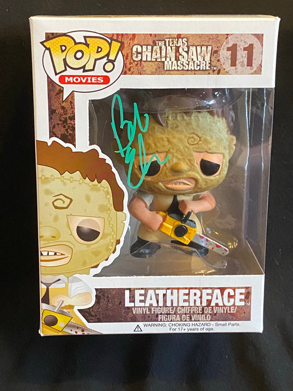 Bob Elmore signed Letherface Funko in green paint pen.