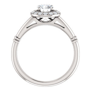 Stunning Halo Style Diamond and Platinum Engagement Ring by Moores