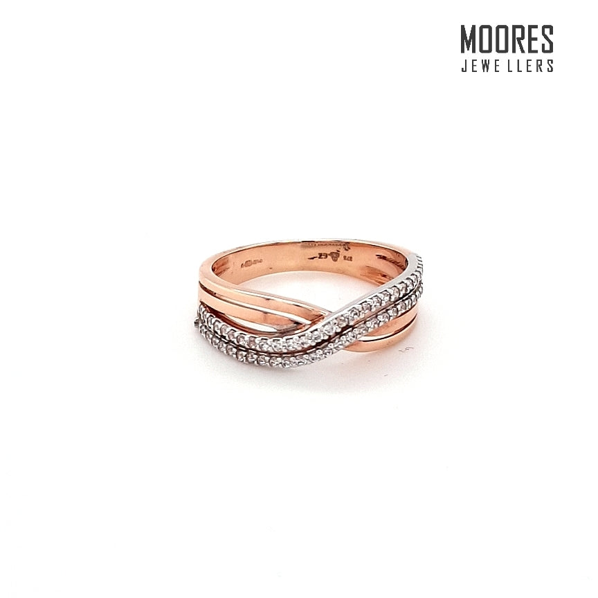 9ct. Rose Gold Double Row Stone Set Ring With a Twist