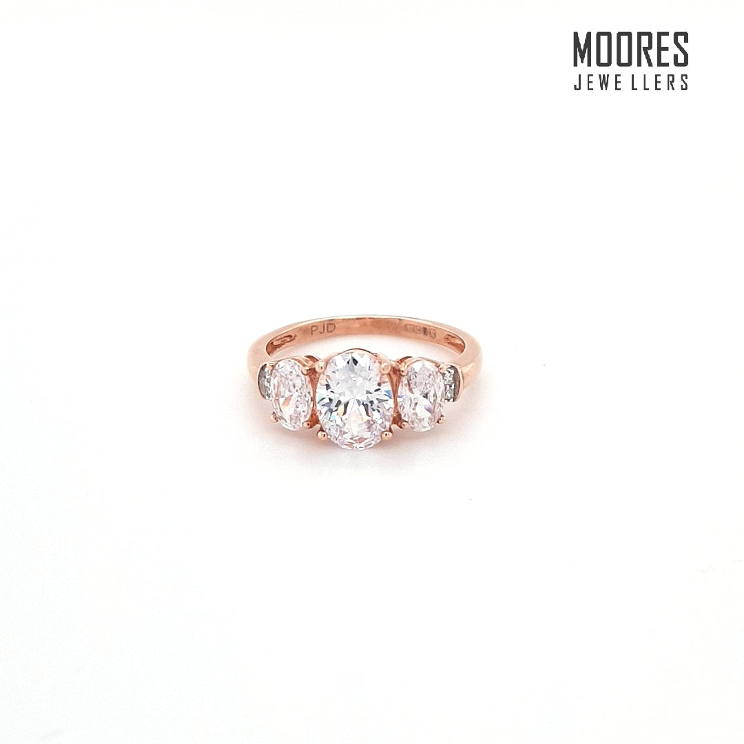 9ct. Rose Gold Oval Cut Graduated Three Stone Ring