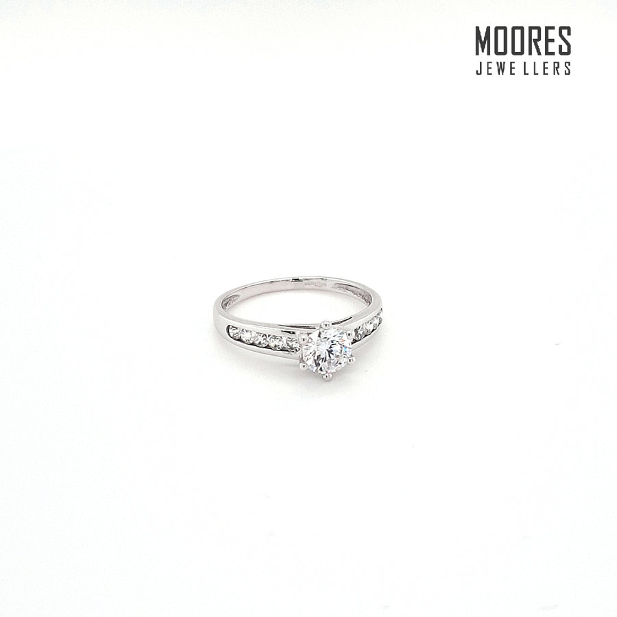 9ct. White Gold Round Brilliant Solitaire Ring with Stone Set Shoulders