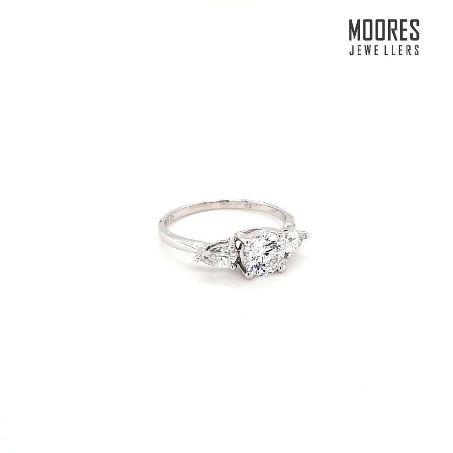 9ct. White Gold Round Brilliant and Pear Shaped Three Stone Ring