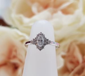 Bespoke Platinum & Diamond Marquise Shaped Halo Engagement Ring by Moores