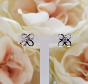 9ct. White Gold Stone Set Floral Pattern Stud Earrings