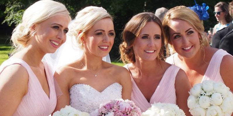 Photograph of a bride with her bridesmaids.