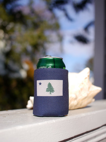 Navy blue can Koozie with two color screen printed image of Original 1901 Maine Flag sitting on front porch railing