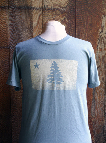 Super soft pale weathered blue short sleeve t-shirt with 1901 Original Maine Flag distressed logo screen printed on the chest