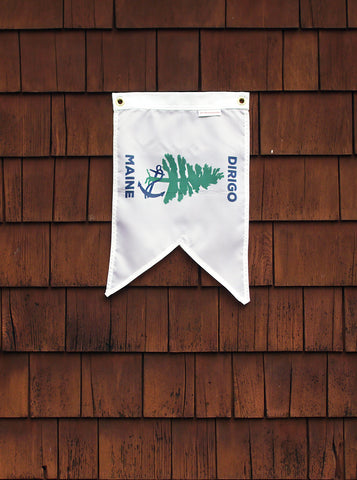 Swallowtail burgee flag with words Dirigo Maine and the Maine Merchant Marine logo with Pine tree and anchor wrapped around trunk white flag with green tree and blue words and anchor