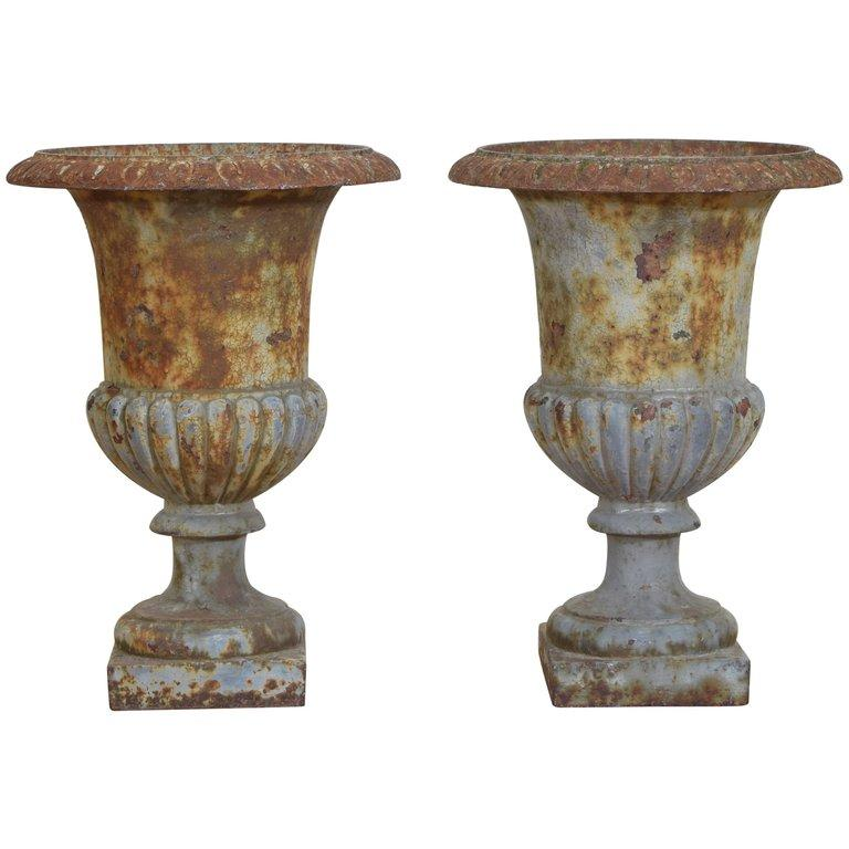 Pair Cast Iron and Parcel Painted Campana Form Urns
