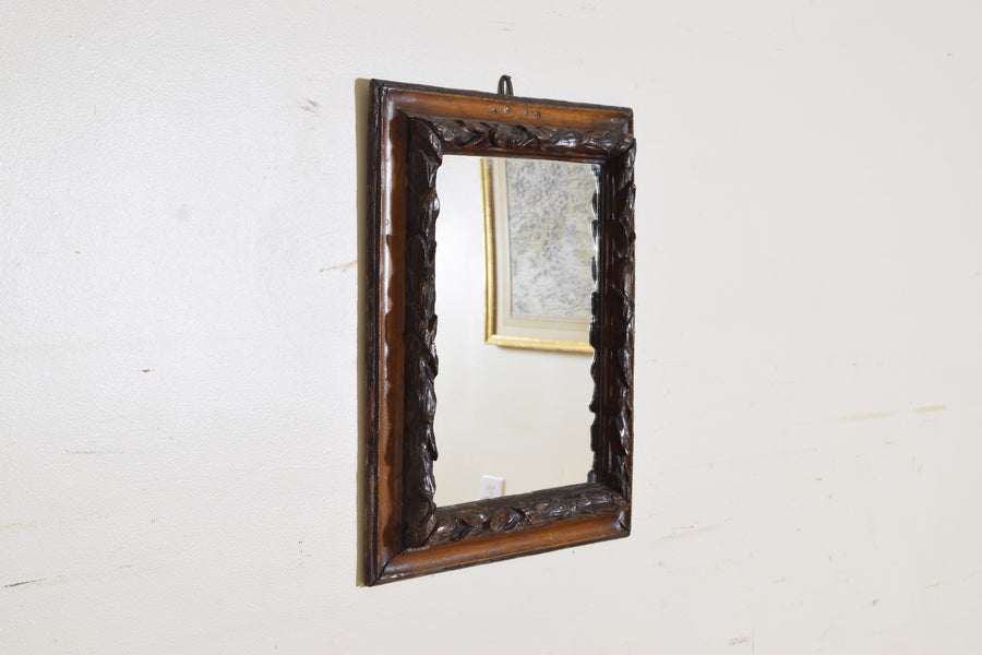Carved Fruitwood, Lacquered, and Gilded Mirror