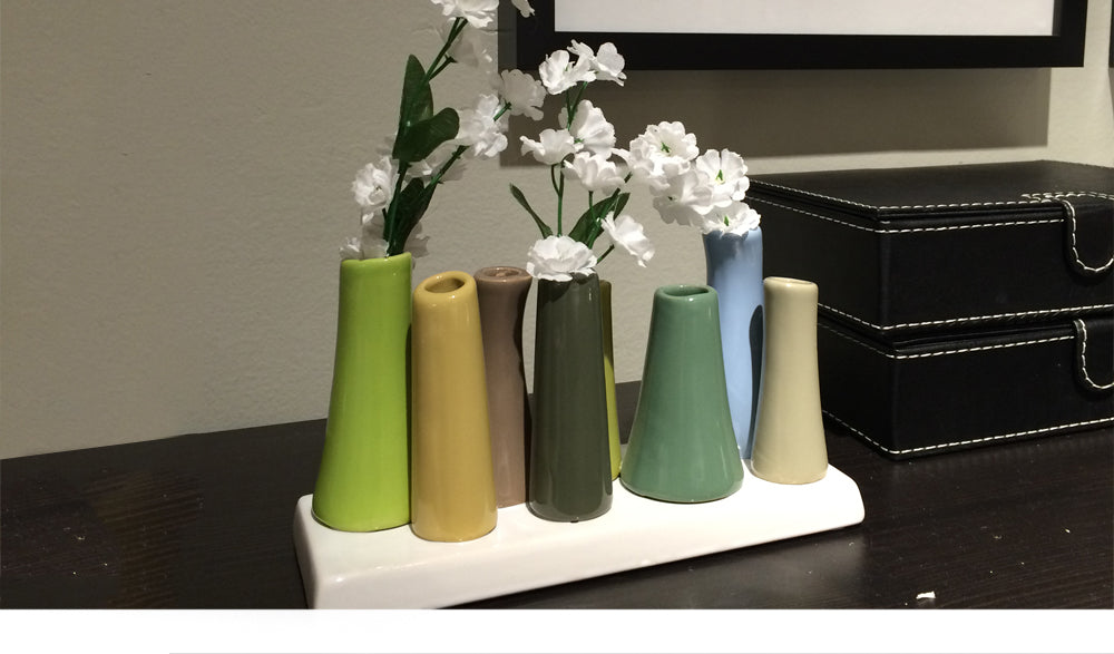 pooley 2 vase on a shelf