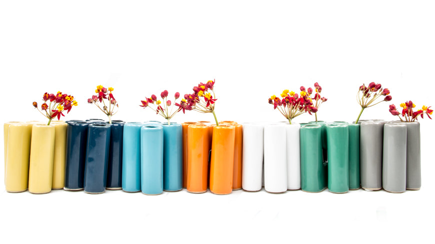 Puzzle Pooley Bud Vase - Lined in a row in Yellow, Navy Blue, Baby Blue, Orange, White, Sage Green and Light Grey