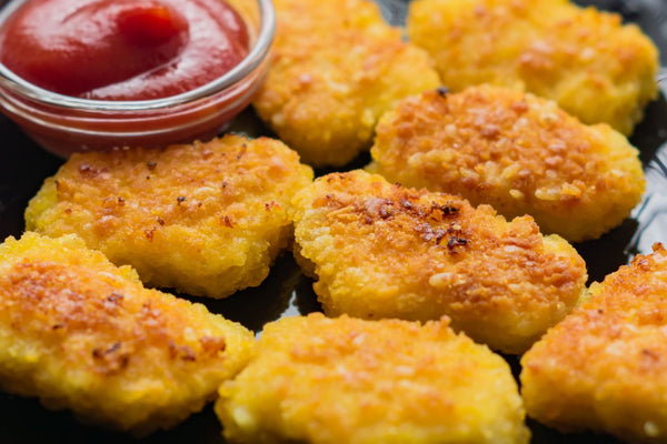 Vegan chicken nuggets with ketchup