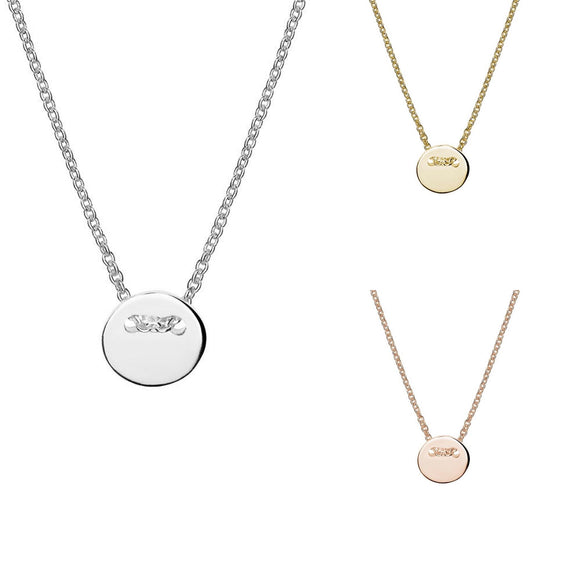 a sterling silver gold and rose gold necklace with tiny circle pendant threaded through chain from have you met charlie in adelaide south australia