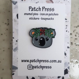 grey koala wearing flower crown enamel pin by patch press from have you met charlie a gift shop with Australian unique handmade gifts in Adelaide South Australia