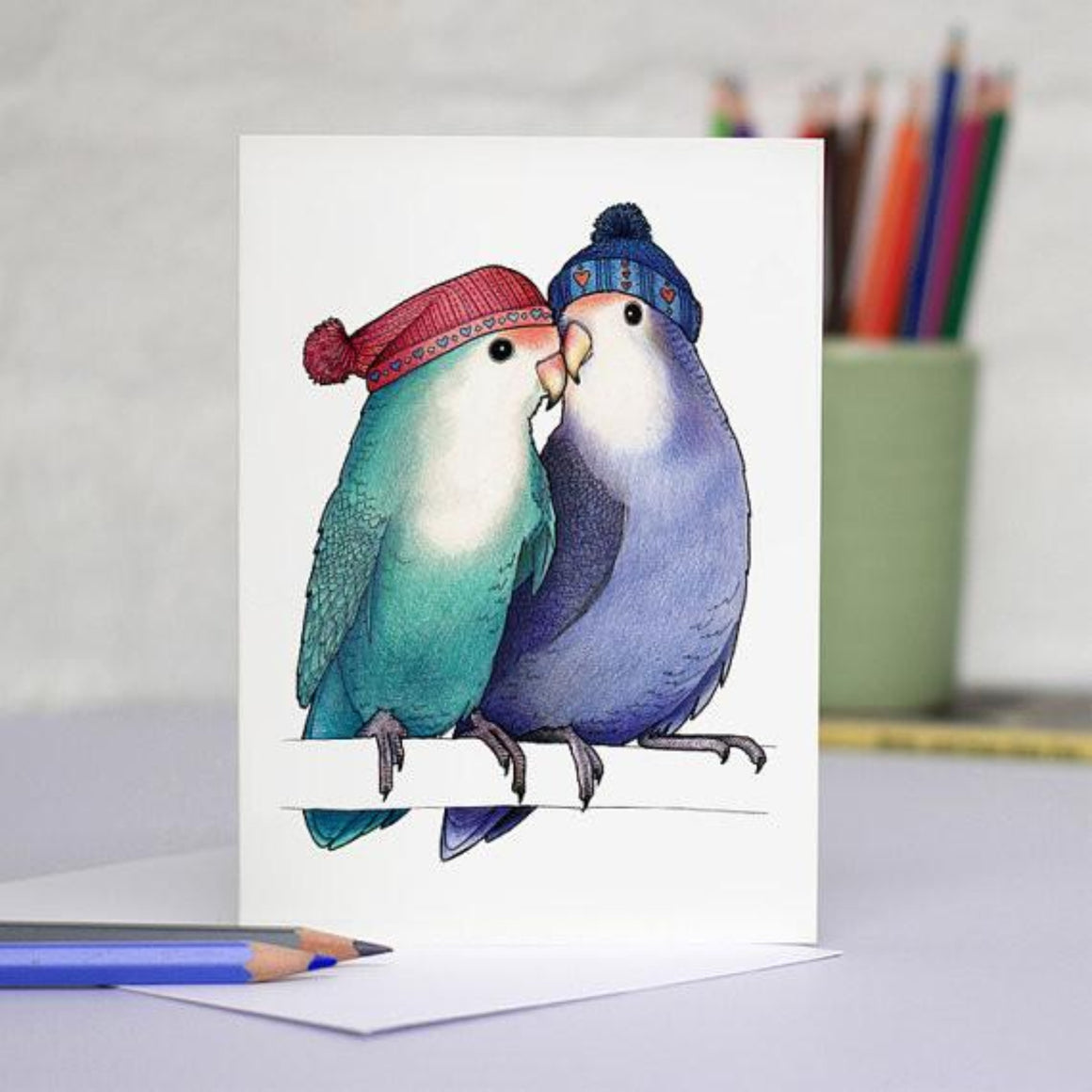 Birds In Hats Greeting Card - Lovebirds in Bobble Hats