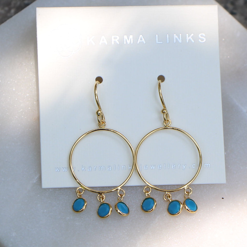 blue bohemian hoops in gold