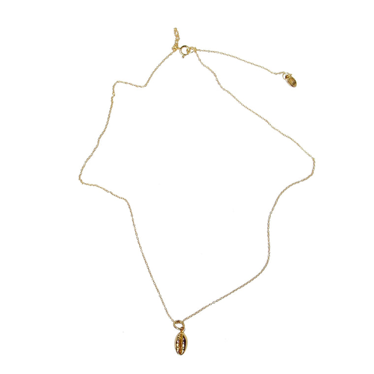 baby cowrie shell necklace in gold  by Karma Links Jewellery