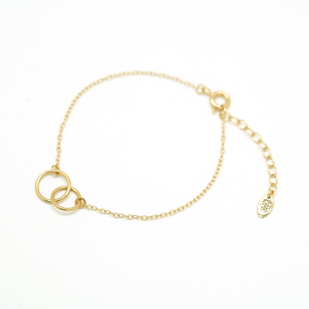 double ring bracelet in gold