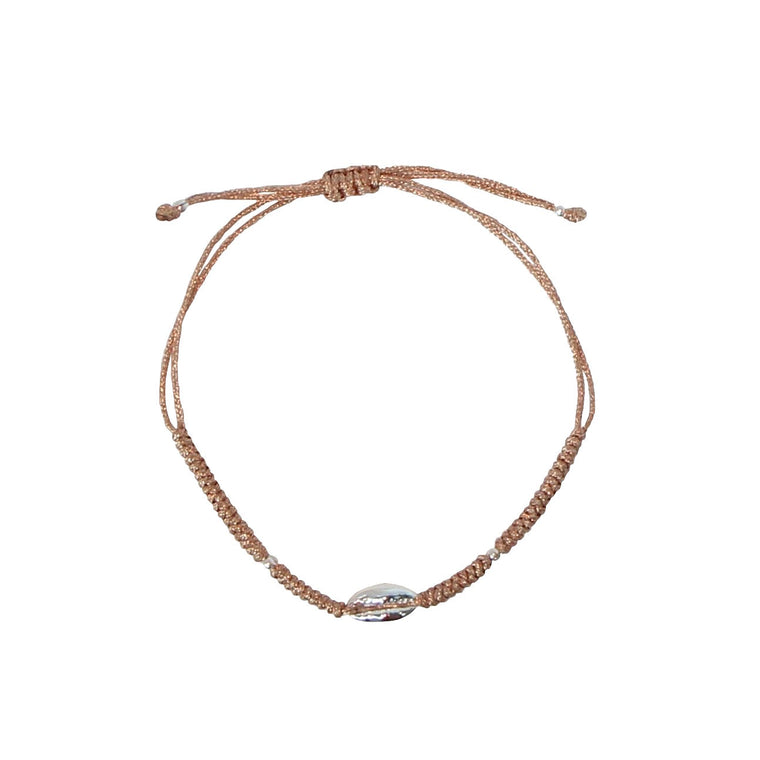 silver cowrie shell on rose gold cord bracelet