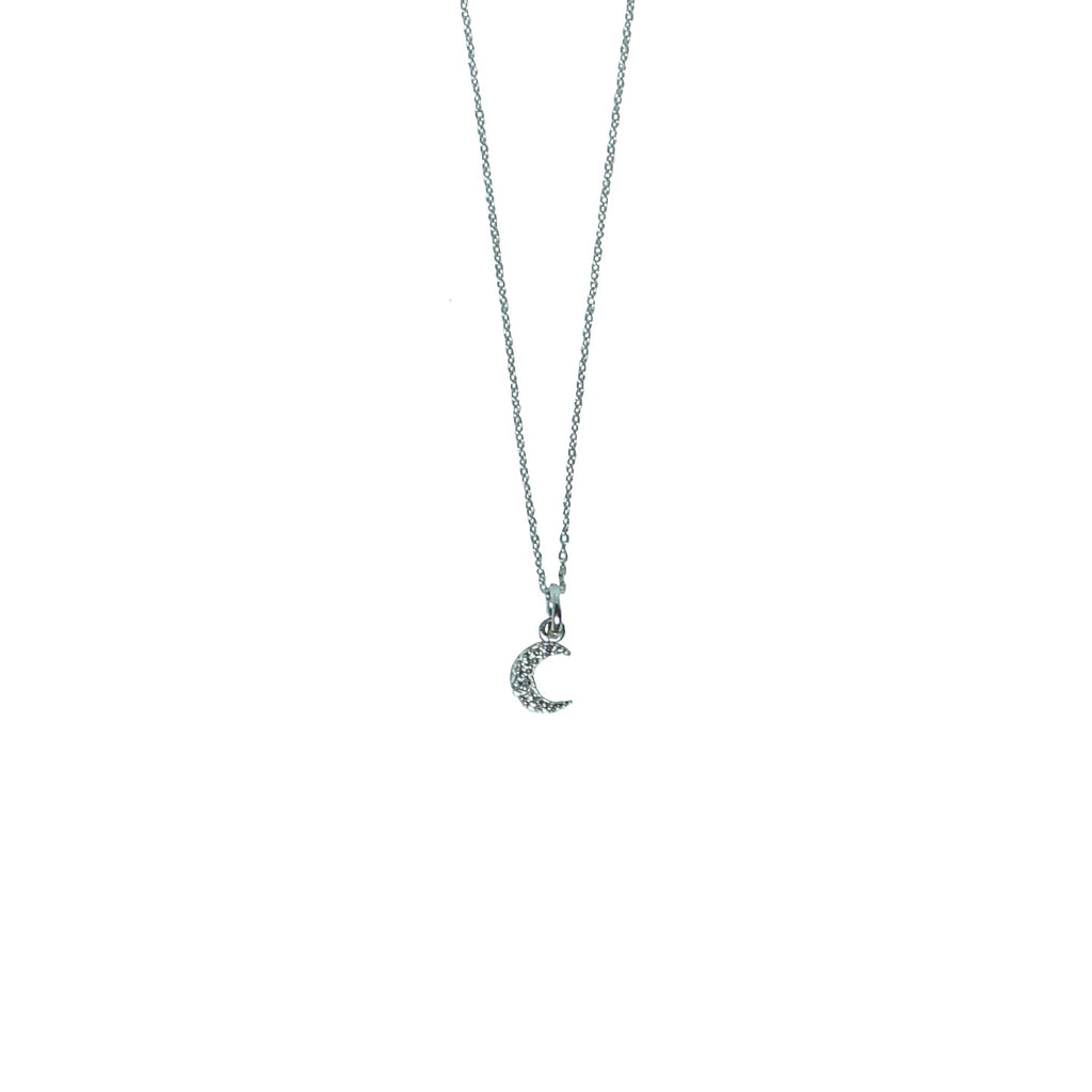tiny crescent moon necklace in silver