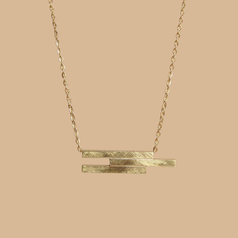 Geo offset gold necklace
