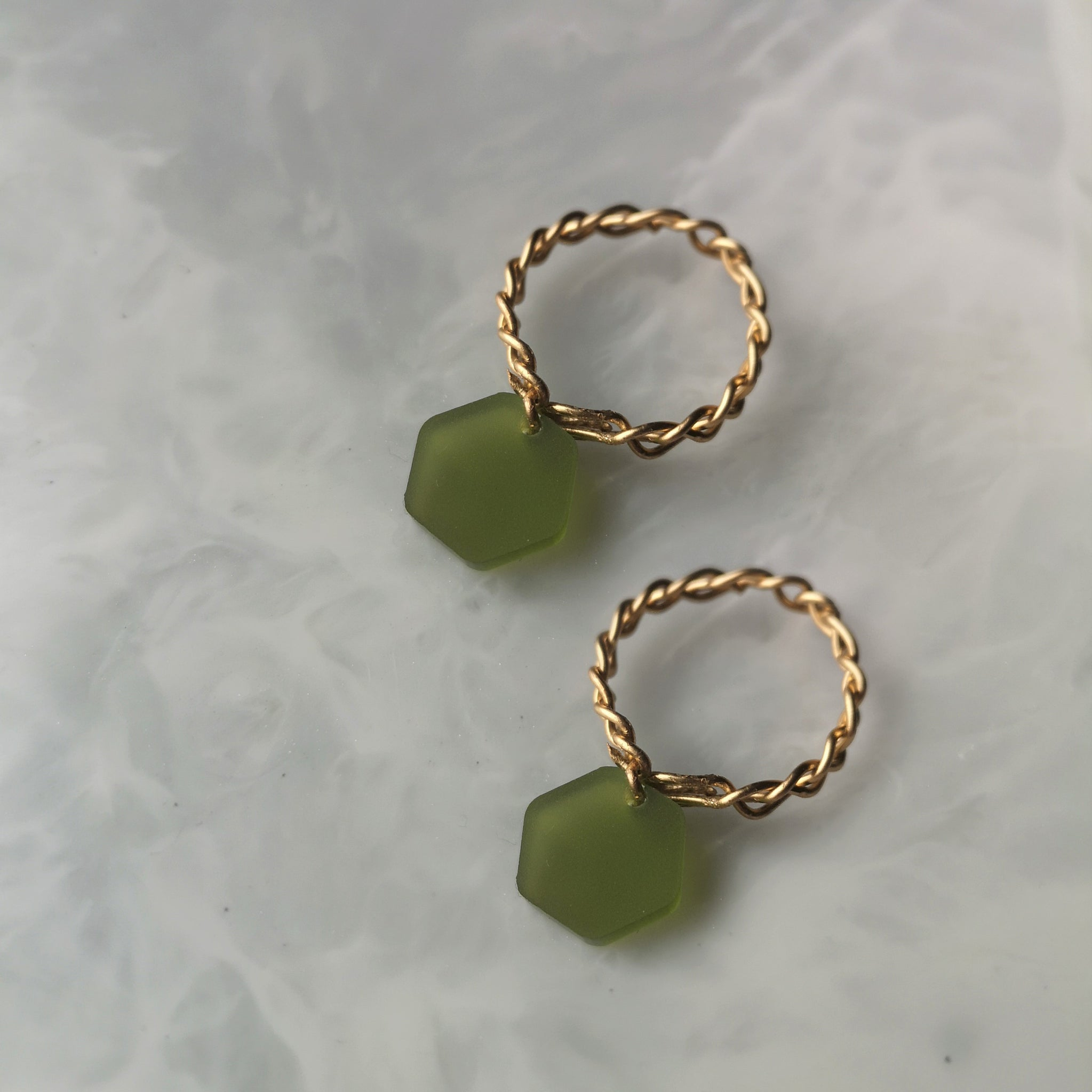 Gold and green hex earrings