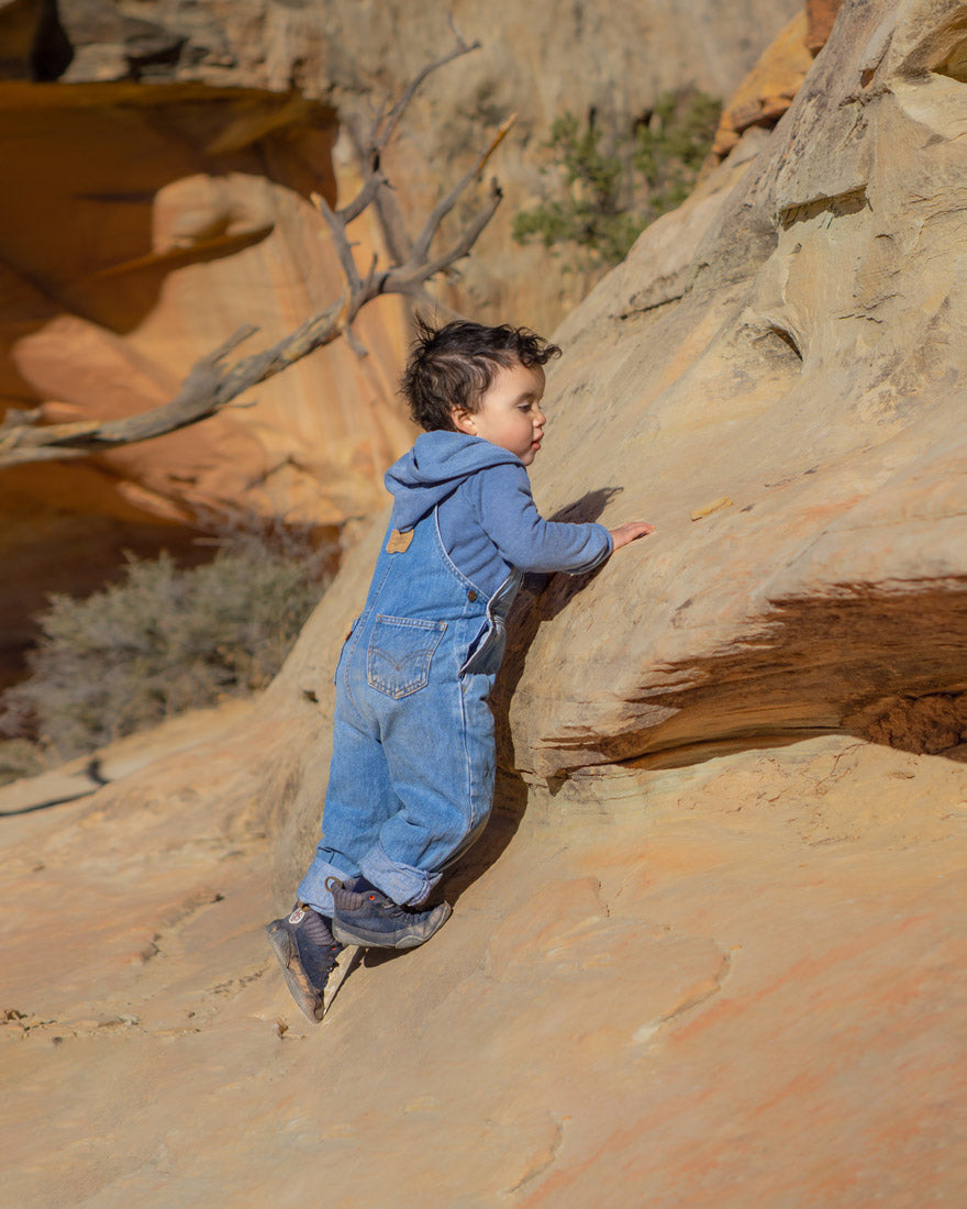 kid climbing up rock formations