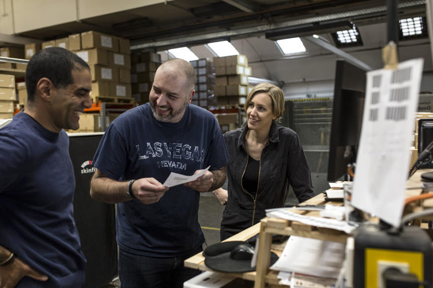 three people laughing at work