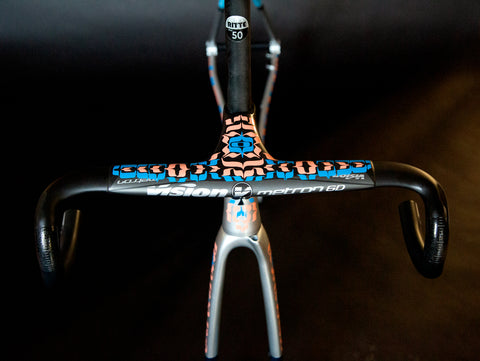photo of the top of a hand painted bike, view from handle bars back
