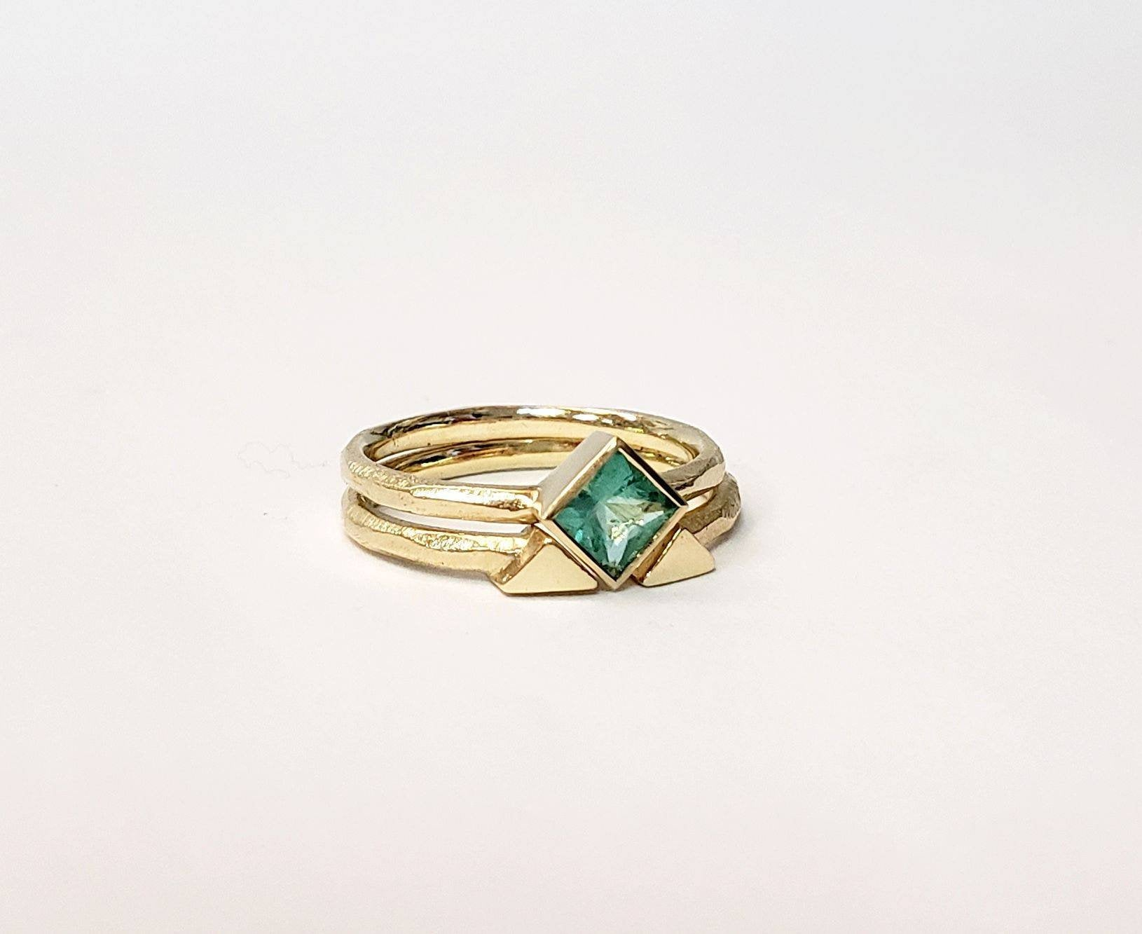 Emerald engagement ring set princess cut square stone with matching spacer ring in gold